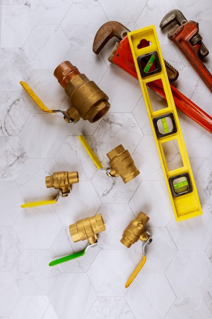 set-tools-for-plumbing-monkey-wrench-pipe-fittings-water-valve-on-level-tape_t20_6mZLE6 (1)